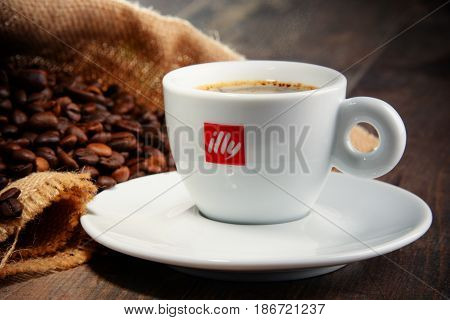 Composition With Cup Of Illy Coffee And Beans