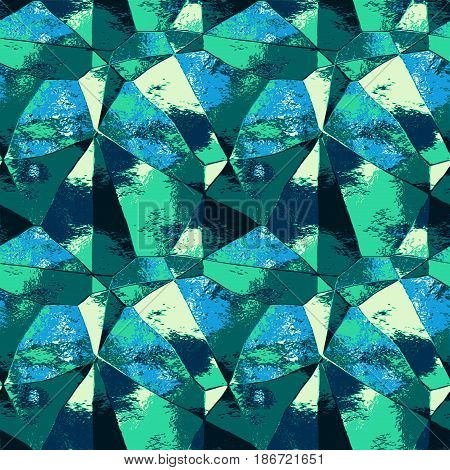Abstract metal pattern with polygonal texture and spectral rays. Green, blue, yellow and turquoise background resembling folded metal foil