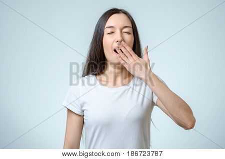 Beautiful Woman Yawns Of Boredom Isolated