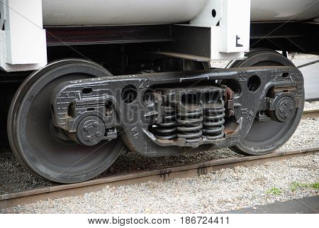 MOSCOW REGION, AUG, 20, 2007: Close up shot of black color Russian new freight car bogie 25 tons per axle with adapter instead axle box for Russian railways. Rail way freight car bogie. Axle load
