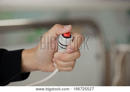 women hand pressing emergency nurse call button