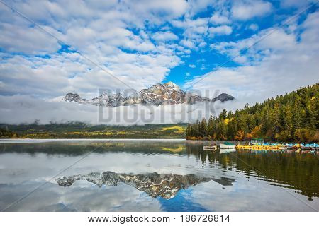 Pyramid Lake in the Canadian Rockies. Mount Pyramid beautifully reflected in the water. The concept of leisure and tourism