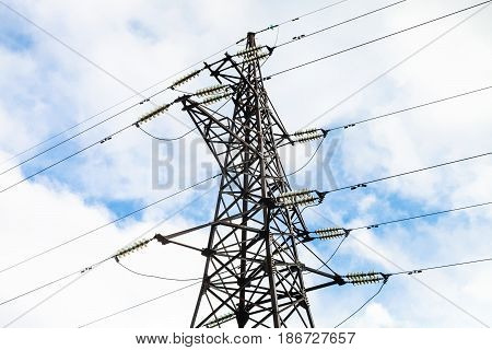 view of tower of High-voltage overhead electric power transmission line and blue sky with white clouds outdoor