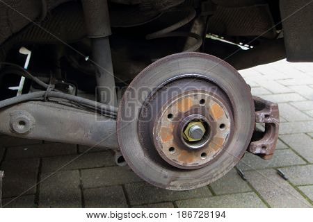 Brake disc of a car on jack for reparation