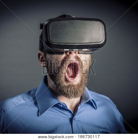 Surprised by virtual reality caucasian man portrait