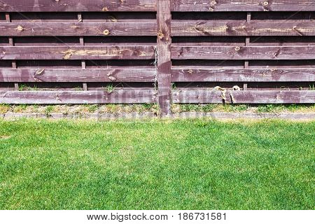 Clipped Lawn Near Wooden Fence