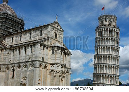 Leaning tower and Pisa cathedral on a bright sunny day in Pisa Italy