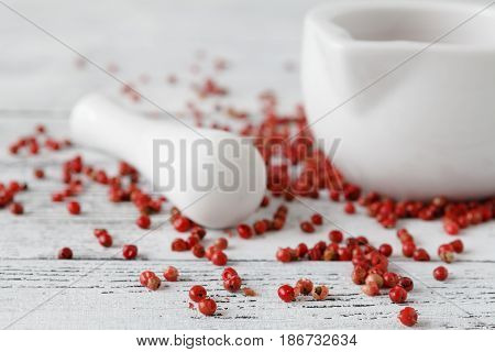 Red peppercorn aroma condiment closeup on table