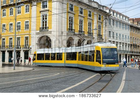 LISBON, PORTUGAL - APRIL 25: New and modern tram arrives at the square Praca do Comercio in Lisbon Portugal on April 25, 2017