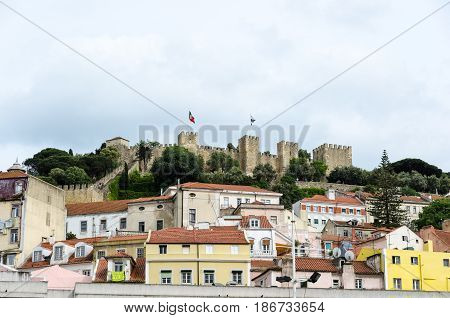 LISBON, PORTUGAL - APRIL 25: The famous Sao Jorge castle on a hill in the center of Lisbon Portugal on April 25, 2017