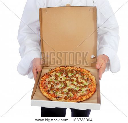 PIZZA. Isolated on white. Room for text. An Unidentifiable Chef holds a fresh baked Pineapple, Ham, Pizza for lunch.