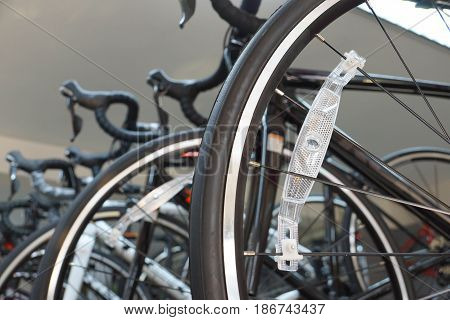 Closeup of road bike tire with light reflector