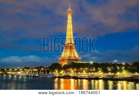PARIS - 26 APRIL2017: Eiffel Tower in the Dusk on April 26 2017. The Eiffel tower is the most visited monument of France.