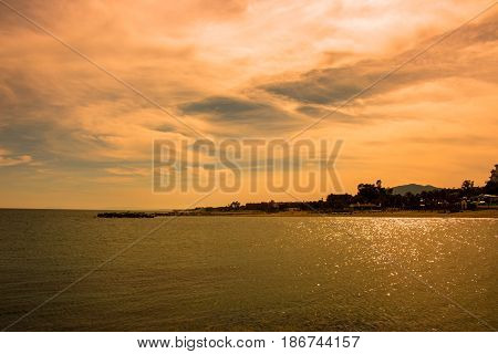 Sunset beach. Beautiful sunset view. Puerto Banus, Marbella city, Costa del Sol, Andalusia, Spain.