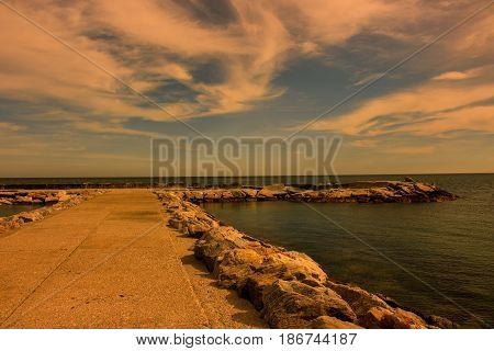 Breakwater. Beautiful sunset view. Mediterranean sea. Puerto Banus, Marbella city, Costa del Sol, Andalusia, Spain.