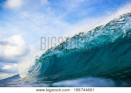 Blue Wave barrel and blue sky in tropics