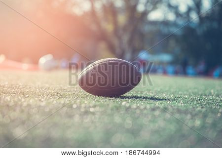 American football game. Close-up of ball on the field.