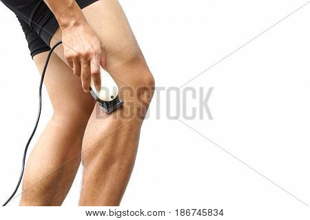 A professional cyclist shaving his legs using hair clipper for improving aerodynamics isolated with copy space to add text