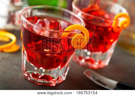 Delicious negroni cocktails with campari gin vermouth and a citrus orange twist.