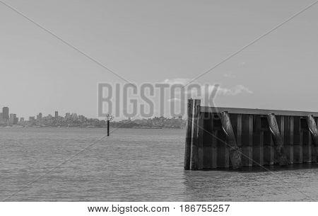 Sea Wall-a black and white photo of a sea wall, the San Francisco Bay and part of San Francisco