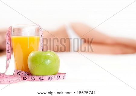 Glass Of Orange Juice With Green Apple And  Measuring Tape