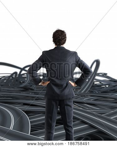 Confused businessman on a tangle of winding roads