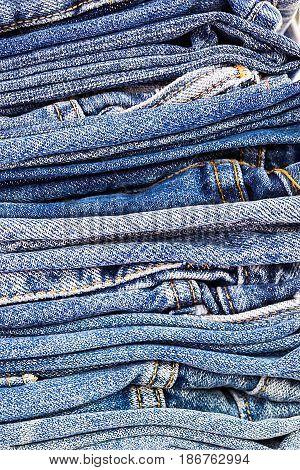 lot of denim blue jean texture is the classic indigo fashion. close-up of denim blue jeans concept for fashion