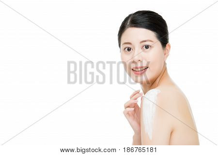 Asian Women Use The Body Lotion On Shoulder.