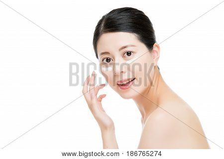 Chinese Asian Women Use Lotion Keep Moist.