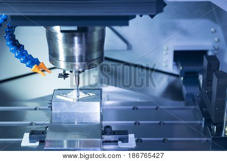 The CNC machine cutting work piece.The hi-precision machining process concept.