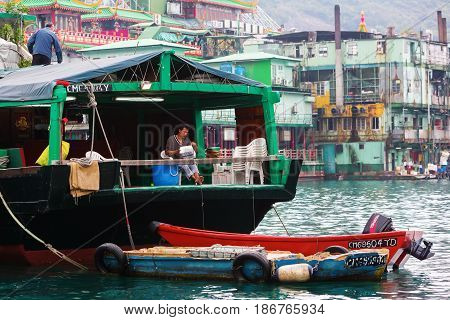 Harbour Scene With Tanka Man In Aberdeen, Hong Kong