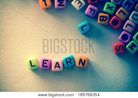 colorful english alphabet cube on white paper background English language learning concept