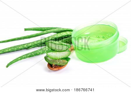 sliced and leaf of fresh aloe vera with aloe vera gel product on wooden plate natural clear gel as the star beauty ingredient for skin care