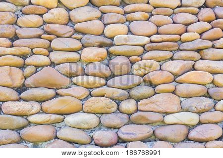River pebbles round stone making wall background