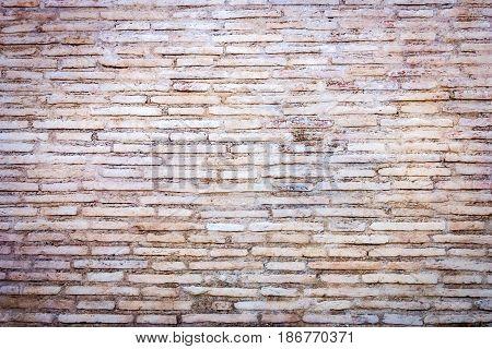 Medieval roman brick wall background. Travertine stone bricks in natural color.