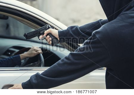 side view of car thief in action