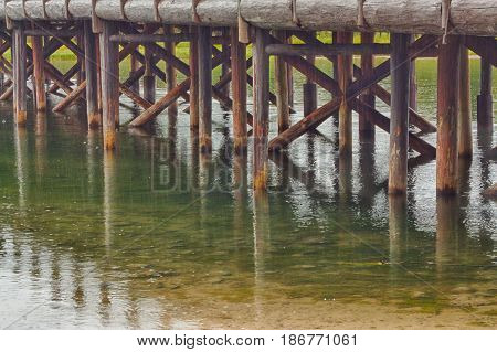 The trestles and their reflections of Fishing Bridge in Yellowstone National Park Wyoming USA..