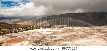 Landscape of a rainbow across Mt. Everts at Mammoth Springs Wyoming USA.