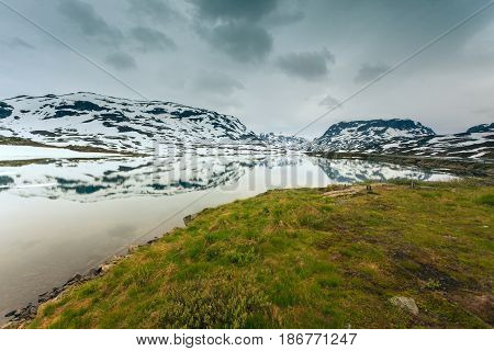Norway hiking area scenic mountains landscape hills and frozen lake