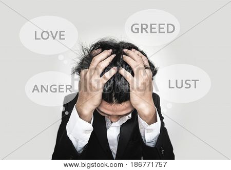 Stress Asian guy, with Love, Greed,Anger and Lust words in speech bubbles