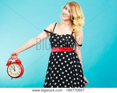 Smiling Girl With Alarm Clock On Blue.