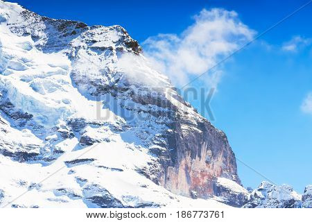 Beautiful Alps Mountain with a hidden face at Jungfrau Switzerland.