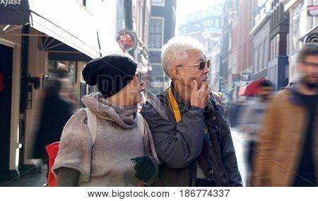 Asian Senior Couple Lost In Europe. Travel After Retirement And Get Confuse During The Trip