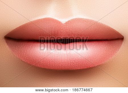 Close-up perfect natural lip makeup beautiful female mouth. Plump sexy full lips. Macro photo face detail. Perfect clean skin fresh lip make-up. Beautiful spa tender lips