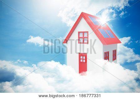 Composite image of 3d house against blue sky