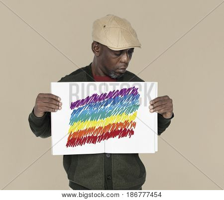 African man holding placard with LGBT icon sign