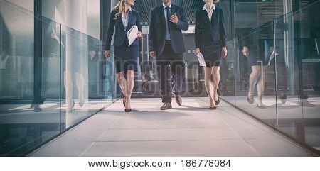 Businesspeople walking in the office corridor