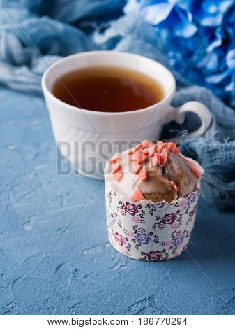 Cup Of Tea On Blue Background With Flowers