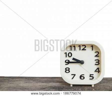Closeup white clock for decorate show a quarter to ten o'clock or 9:45 a.m. on old brown wood desk isolated on white background with copy space