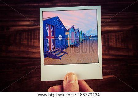 Hand Holding Polaroid Photograph Of Famous Brighton Beach Boxes In Melbourne, Australia. Travel Memo